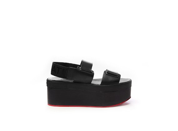 Sandal with eyelets and Velcro on a red flatform sole