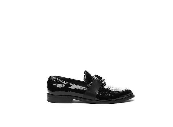 Black patent moccasin with piercing