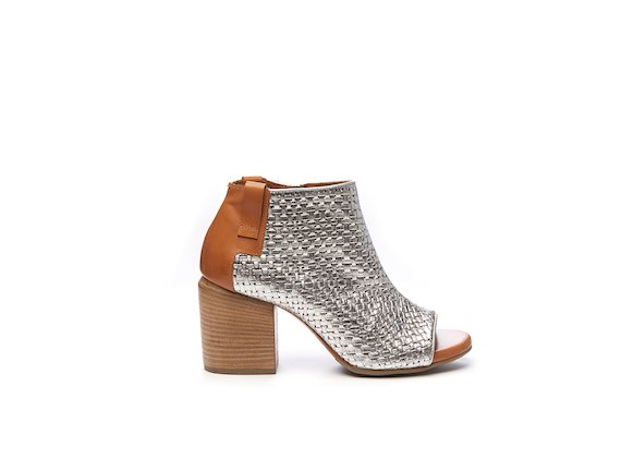 Peep-toe half boot in silver braided leather