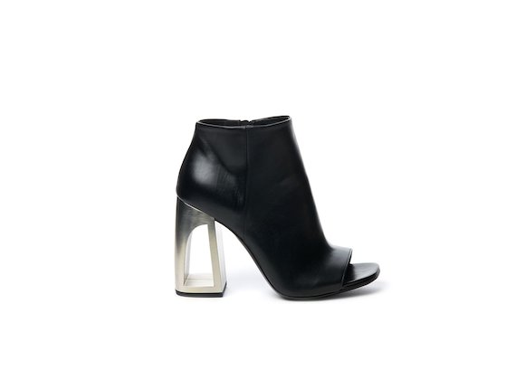 Peep-toe half boot with metallic hole heel