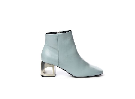 Powder blue leather half boot with hole heel