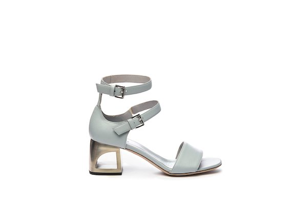 Sandal with closed heel and powder blue mini straps