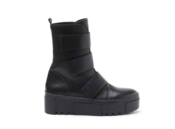 Military boots with Velcro straps and rubber box sole