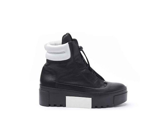 Hiking-style heeled ankle boots with rubber box sole