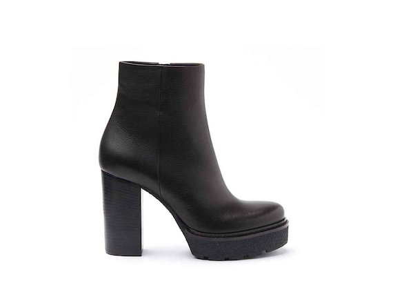 Black leather heeled ankle boots with crepe platform and leather-covered heel