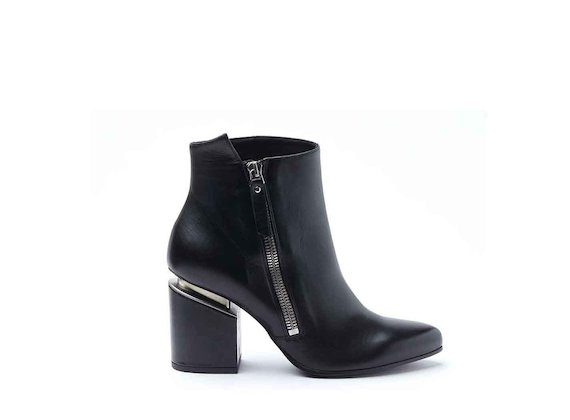 Heeled ankle boots with maxi zip and suspended heel