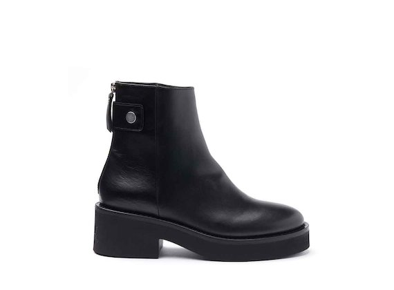 Black leather heeled ankle boots with press-stud and rubber sole