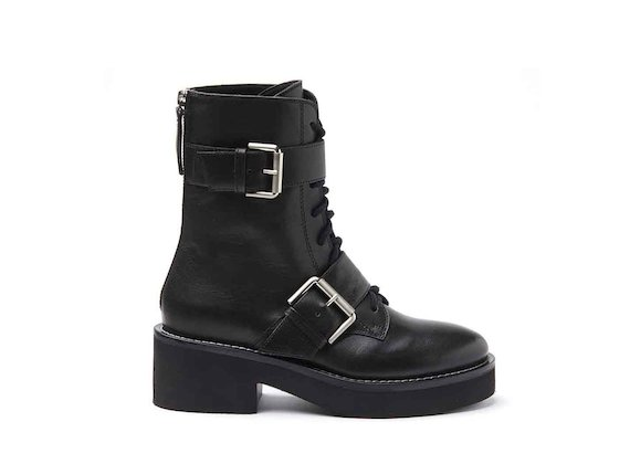 Military boots with buckles and rubber sole