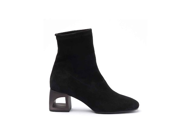 Black stretch suede heeled ankle boots with perforated heel