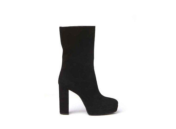 Black suede stove pipe boots with suede-covered platform and heel