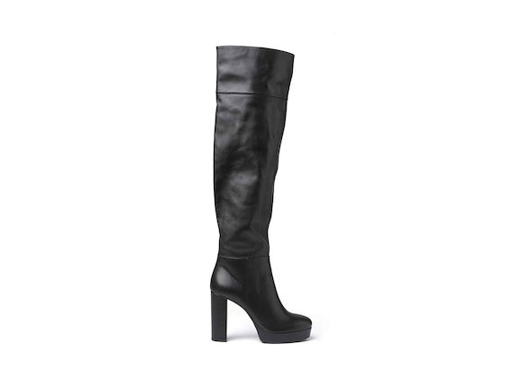 Black leather thigh-high stove pipe boots with leather-covered platform and heel