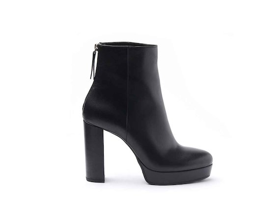 Black leather heeled ankle boots with leather-covered platform and heel