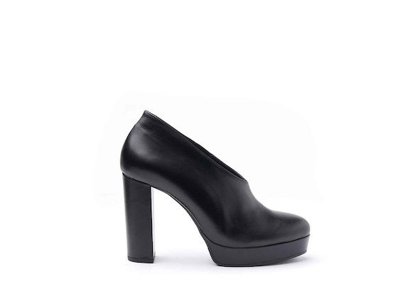 Black leather shoes with leather-covered platform and heel
