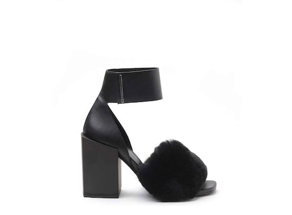 Sandals with fur band and ankle strap with high black block heel