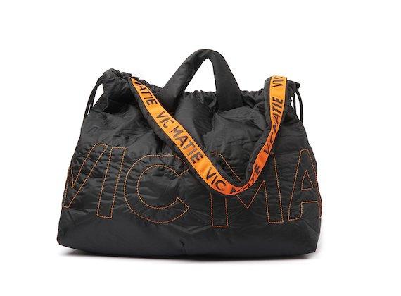 Penelope <br />Reversible backpack with contrasting shoulder strap
