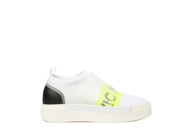 White sock sneaker with neon yellow logo