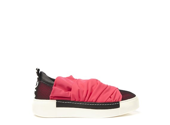 Mesh sneaker with fuchsia draped fabric strips