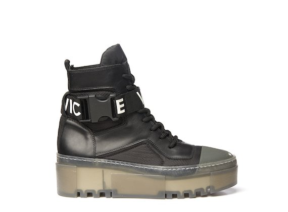 Black combat boot with transparent sole
