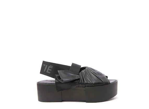 Black sandal with draped upper