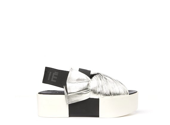 Silver sandal with a draped upper