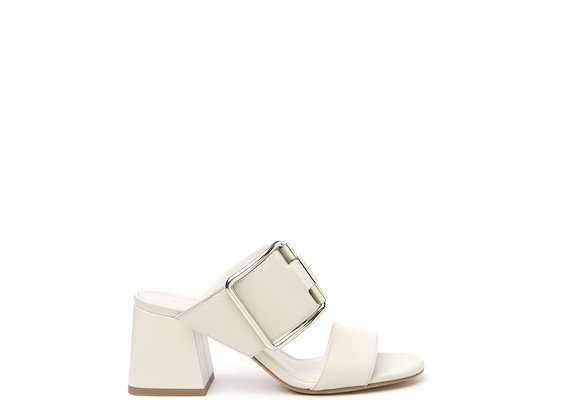 White sandal with flared heel and buckle