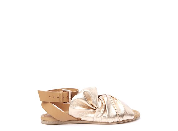 Flat sandal with rose gold draped leather upper