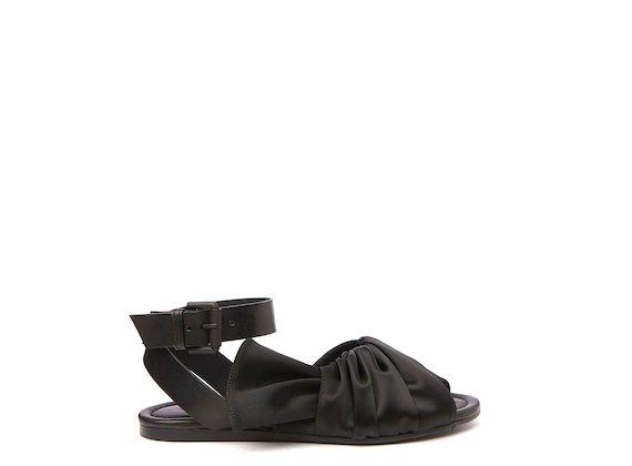 Flat sandal with black draped upper