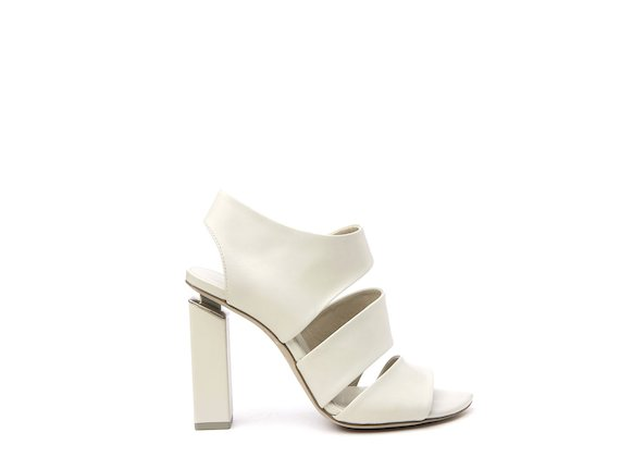 White sandal with asymmetric bands and suspended heel
