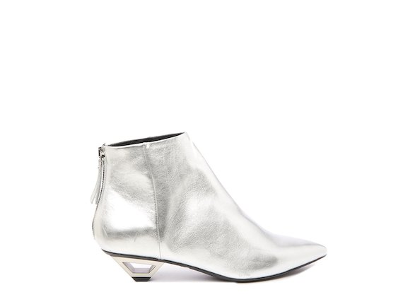 Silver ankle boot with hollow metal heel