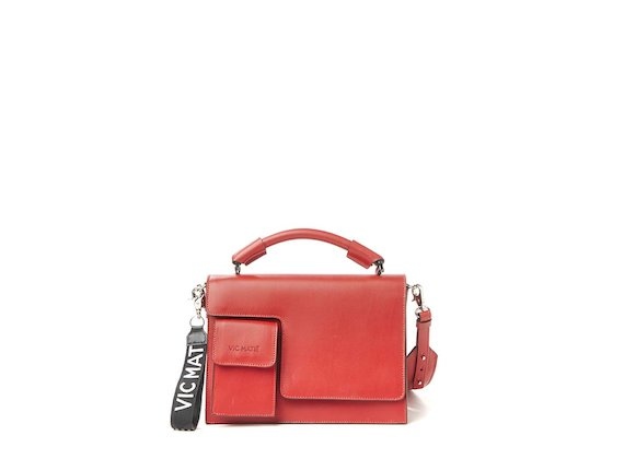 Corinne<br>Red satchel with contrasting edges