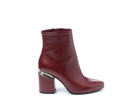 Red ankle boot with suspended heel