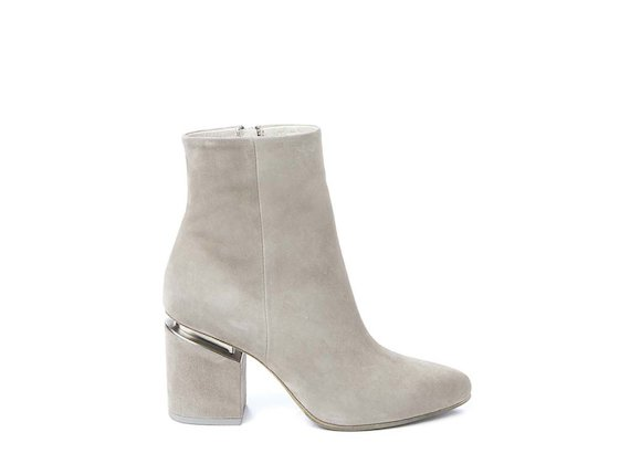 Beige ankle boot with suspended heel