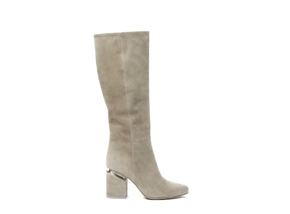 Beige stove pipe boot with suspended heel