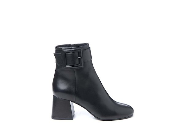Ankle boot with flared heel and maxi buckle