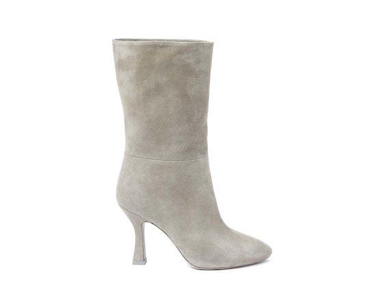 Beige fold-over half boot with spool heel