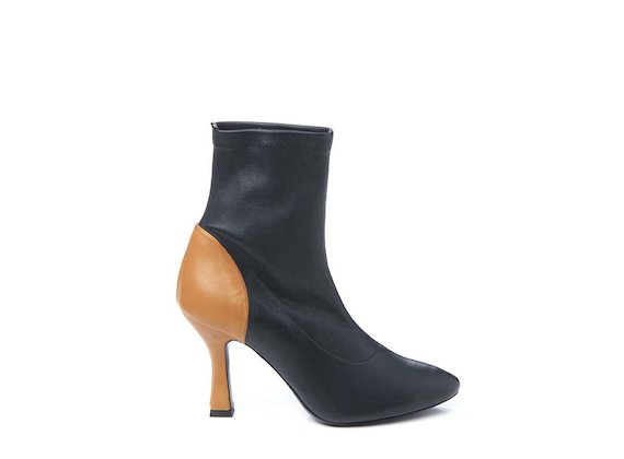 Black stretch heeled ankle boot with contrasting leather heel