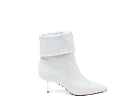 White fold-over half boot with metallic heel