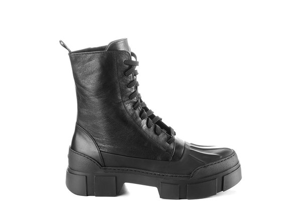 Men's black calfskin combat boots in rubberised leather with lugged sole