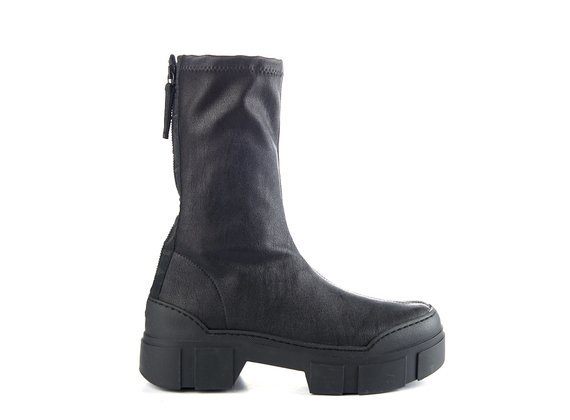Ankle boots in black, stretchy faux leather with lugged sole