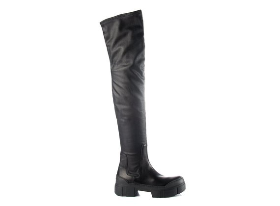 Black thigh-high boots in black leather/faux leather with lugged sole - Black