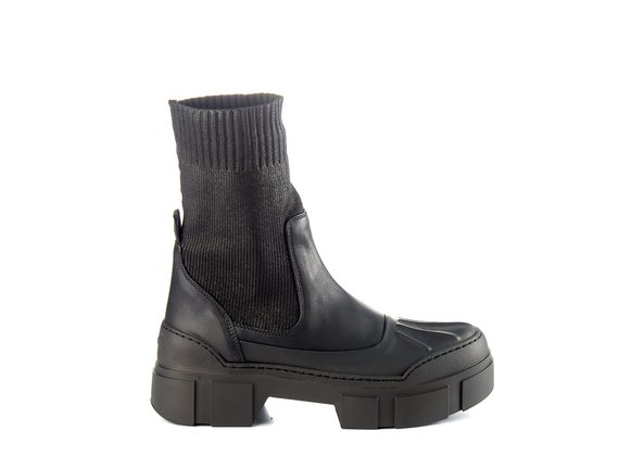 Black ankle boots in rubberised leather and knit fabric with lugged sole