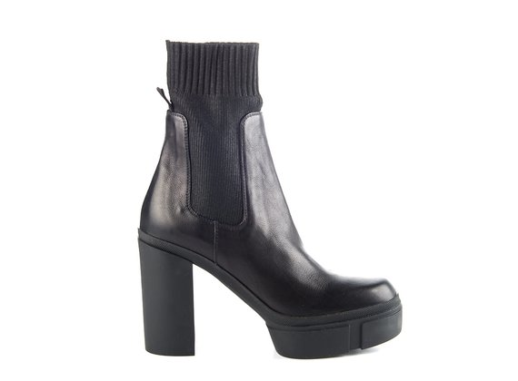 Black leather ankle boots with rubber platform