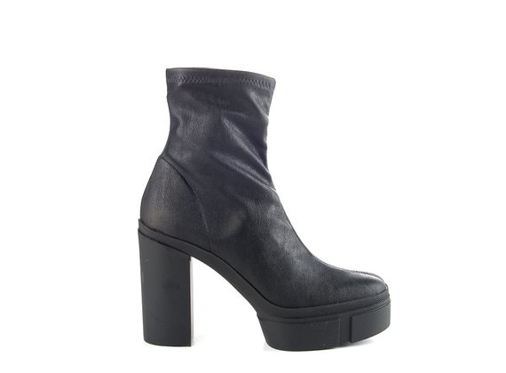 Black faux leather ankle boots with rubber platform