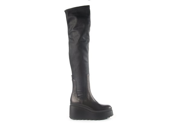 Black thigh-high boots in leather/faux leather with wedge