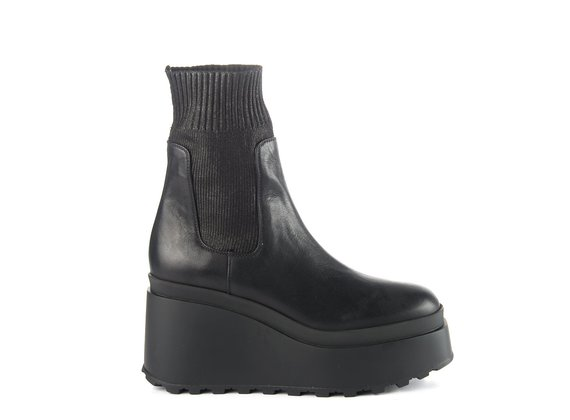 Black ankle boots in leather/knit fabric with wedge