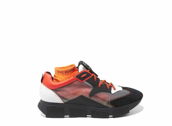 Black/orange running shoes with see-through upper