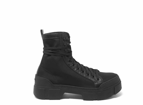 Black combat boots with lug soles
