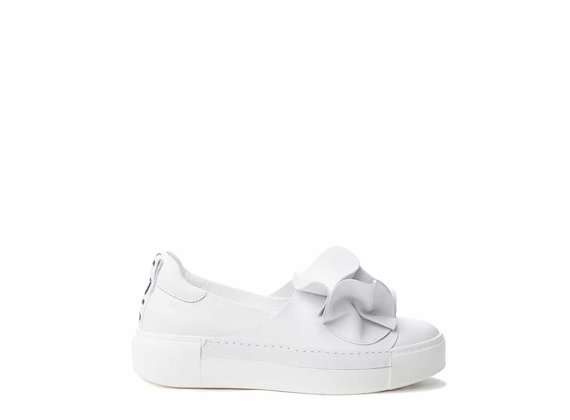 White slip-ons with large origami flower