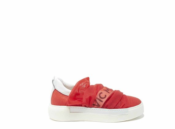 Draped-effect slip-ons in red mesh