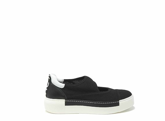 Black mesh slip-ons with cut-out